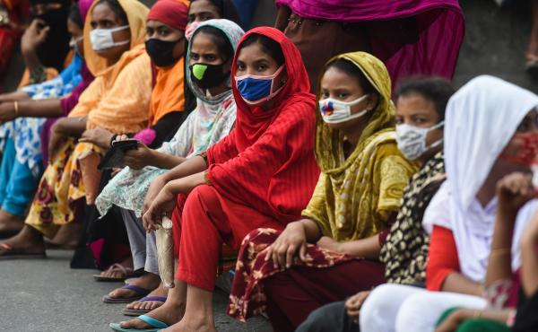 Workers from the garment sector block a road during a protest to demand payment of due wages, in Dhaka, Bangladesh, in April. Thousands of garment workers who produce items for top Western fashion brands protested against unpaid wages, saying they were mo