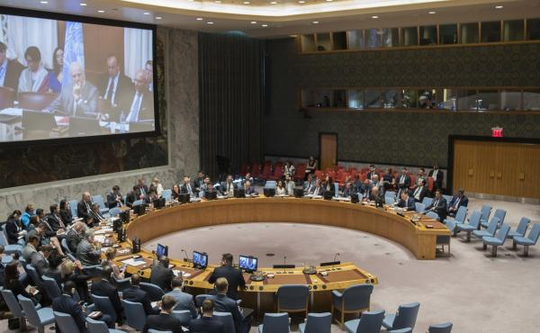 United Nations special envoy to Syria Staffan de Mistura is seen on a video screen as he listens to a Security council meeting on Syria at U.N. headquarters in June about the possible use of sarin gas in an attack that killed more than 90 people.