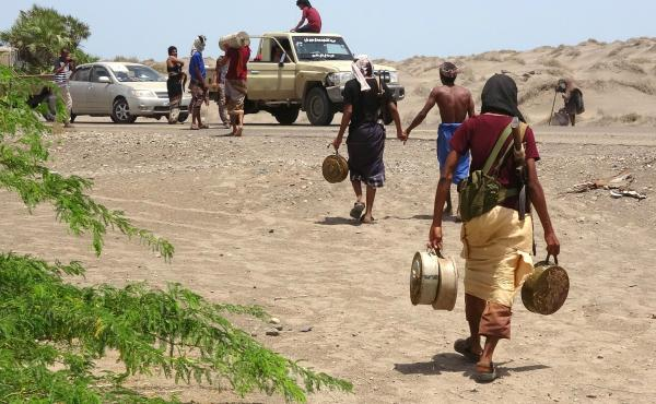 Yemeni fighters loyal to the government carry explosives and land mines believed to have been planted by Houthis on June 8 near Hudaydah.