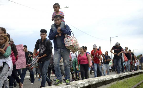 Thousands of Honduran migrants and families walk towards the southern Mexico border from Guatemala. Many say they are headed to the U.S. The White House said on Tuesday that a record number of migrant families have arrived at the Southwest border over the