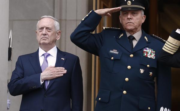 Then-Mexican Defense Secretary Gen. Salvador Cienfuegos (right) with then-U.S. Defense Secretary Jim Mattis at the Pentagon in 2017. Cienfuegos was arrested Thursday at Los Angeles International Airport.