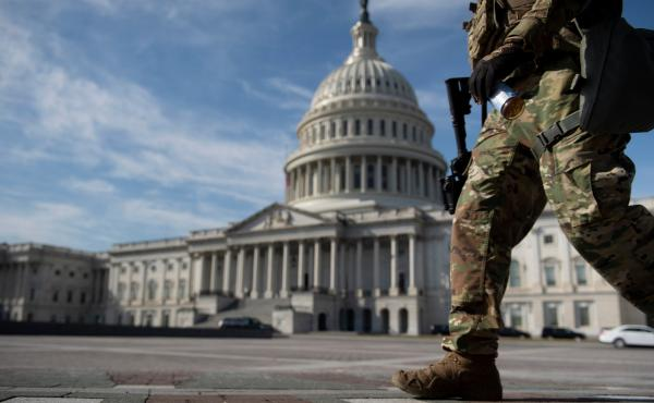 A member of the National Guard walks on Capitol Hill Tuesday, before the first day of former President Donald Trump's Senate impeachment trial.
