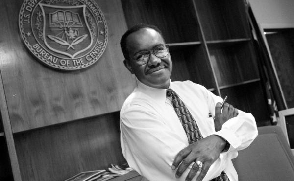 James F. Holmes, the first-ever person of color to oversee the U.S. head count, stands inside his office at the Census Bureau's former headquarters in Suitland, Md., in 1998, when Holmes served as acting director for about nine months.