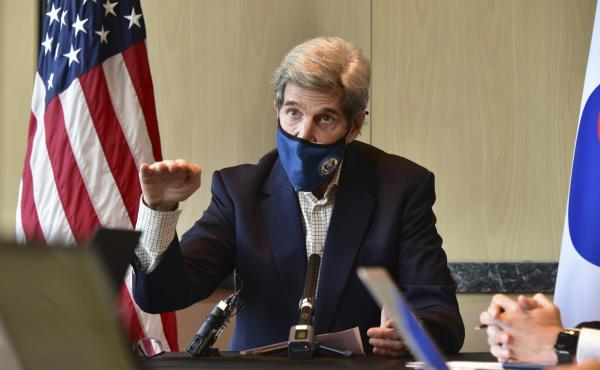 U.S. special envoy for climate John Kerry speaks during a roundtable meeting with reporters in Seoul on Sunday. The United States and China have agreed to cooperate with other countries to curb climate change, just days before a virtual summit of world le