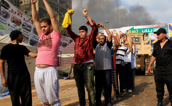 U.S. citizen Moustafa Kassem was arrested amid a massive crackdown on sit-ins in Cairo in Aug. 2013. Police are shown arresting men as they clear a sit-in by supporters of ousted Islamist President Mohammed Morsi.