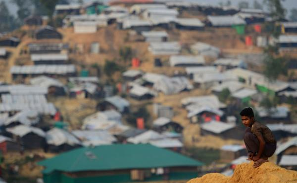 A Rohingya refugee boy looks on at Balukhali refugee camp in the Bangladeshi district of Ukhia on Wednesday. An estimated 618,000 Muslim Rohingya have fled mainly Buddhist Myanmar since a military crackdown was launched in Rakhine in August. Refugees desc