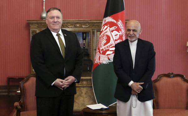 Secretary of State Mike Pompeo (left) stands with Afghan President Ashraf Ghani at the Presidential Palace in Kabul, Afghanistan, on Monday. Pompeo says the U.S. will cut $1 billion in aid to Afghanistan.