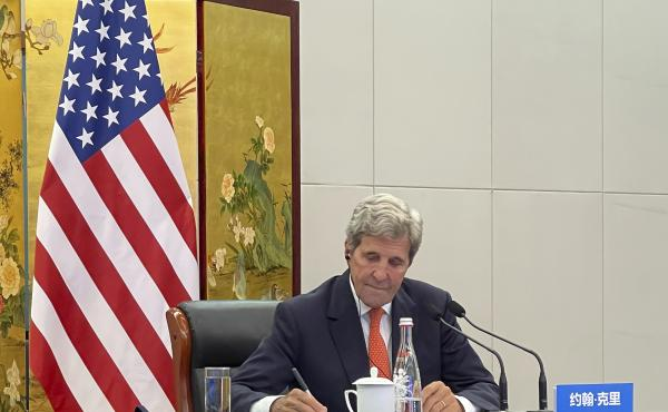 In this photo provided by the U.S. Department of State, U.S. Special Presidential Envoy for Climate John Kerry attends a meeting with Chinese Foreign Minister Wang Yi via video link in Tianjin, China, Wednesday, Sept. 1, 2021. Wang warned Kerry on Wednesd