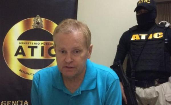 Eric Conn, who was sentenced in absentia to 12 years in prison after fleeing justice this summer, has been arrested in Honduras. He's seen here in a photo released by the Public Ministry of Honduras.