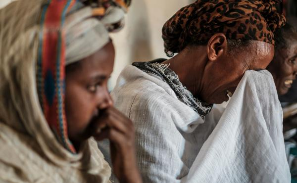 People mourn the victims of a massacre allegedly perpetrated by Eritrean Soldiers, at the house of Beyenesh Tekleyohannes, in the village of Dengolat, North of Mekele, the capital of Tigray. The U.S. announced visa and aid restrictions to Ethiopia due to