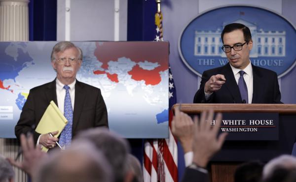 Treasury Secretary Steven Mnuchin (right) and National Security Adviser John Bolton announce sanctions against Venezuela at the White House Monday.