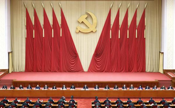 Chinese President Xi Jinping, center, also general secretary of the Chinese Communist Party, leads the fifth plenary session of the party's 19th Central Committee in October in Beijing. The U.S. State Department on Thursday tightened travel restrictions o