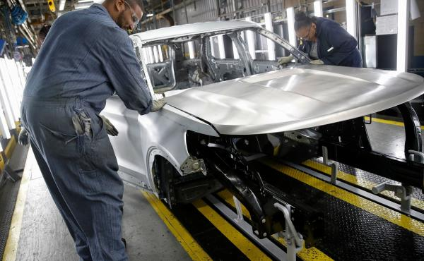 Workers assemble cars at Ford's newly renovated assembly plant in Chicago. Factories lost 12,000 jobs in December. The manufacturing sector has been hard hit by the trade war as well as slowing demand overseas.