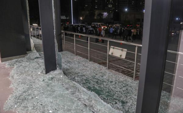 Shattered glass is on the ground following a rocket attack in Irbil, the capital of the northern Iraqi Kurdish autonomous region, on Feb. 15. On Thursday, the U.S. launched airstrikes targeting Iranian-backed groups in eastern Syria in response to recent