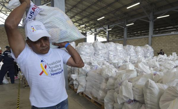 A volunteer carries a bag with U.S. humanitarian aid goods in Cúcuta, Colombia, along the border with Venezuela, on Feb. 8.