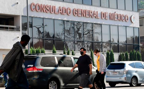 Pedestrians walk past Mexico's Consulate General in Los Angeles in October, shortly after ex-Mexican Defense Secretary Salvador Cienfuegos Zepeda's arrest at Los Angeles International Airport at the DEA's request. Charges were later dropped.