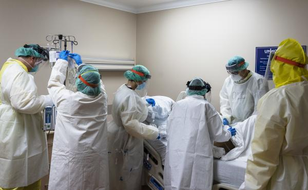 Members of the medical staff treat a patient in the COVID-19 intensive care unit at the United Memorial Medical Center on July 2, in Houston, Texas. More than 700 military health professionals are being sent to regions with spikes in coronavirus cases, in