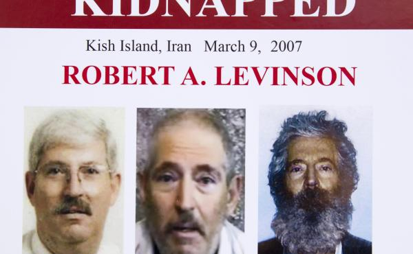 An FBI poster from 2012 shows (from left) former FBI agent Robert Levinson before his capture, in a video released by his kidnappers and as a composite image of what he might look like after five years in captivity.