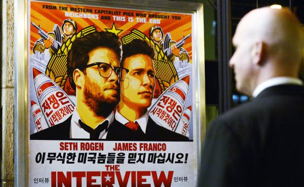 U.S. intelligence officials believe North Korea was centrally involved in the recent attack on Sony Pictures' computer network — possibly out of retribution for its film The Interview. Above, a security guard stands outside a theater during the film's p