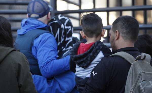 Honduran asylum seekers enter the U.S. at San Diego's Otay Mesa port of entry, as seen from Tijuana, Mexico.