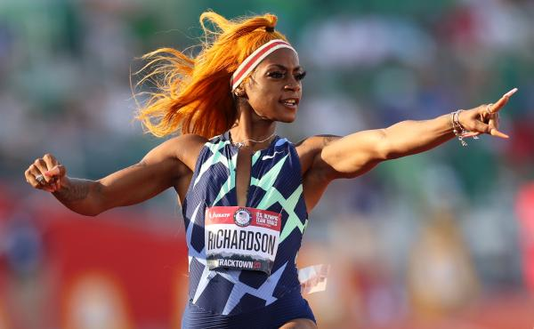 Sha'Carri Richardson celebrates in the 100-meter semifinal last month at the U.S. Olympic track and field team trials in Eugene, Ore. However, a positive drug test disqualified her result at the trials.