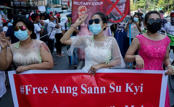 Women protest on Wednesday against the military coup that toppled the government led by Aung San Suu Kyi earlier this month. The Biden administration on Thursday announced sanctions against several of the coup leaders.