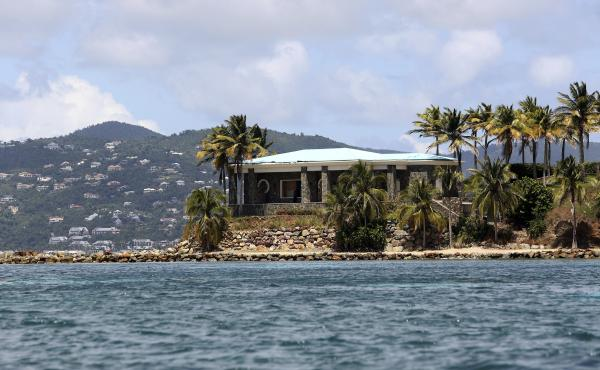 A view of Jeffrey Epstein's stone mansion on Little St. James Island. Prosecutors in the Virgin Islands on Tuesday filed a civil lawsuit that accuses Epstein of human trafficking that victimized young women and children as young as 11 years old. Some of t