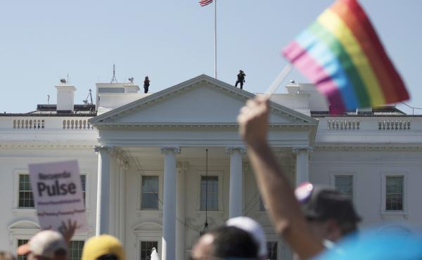 The Biden administration says the government will protect gay and transgender people against sex discrimination in health care. In this 2017 photo, Equality March for Unity and Pride participants march past the White House in Washington.