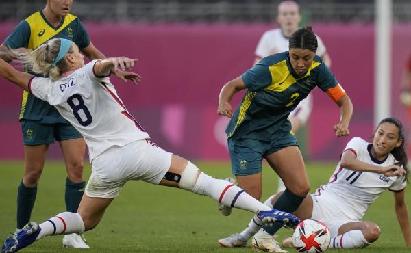 Australia's Sam Kerr and Julie Ertz of the U.S. battle for the ball during a women's soccer match at the Tokyo Olympics on Tuesday.