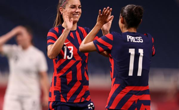 Alex Morgan (#13) celebrates another Team USA goal against New Zealand with teammate Christen Press (#11) at the Tokyo Olympics on Saturday in Saitama, Japan.
