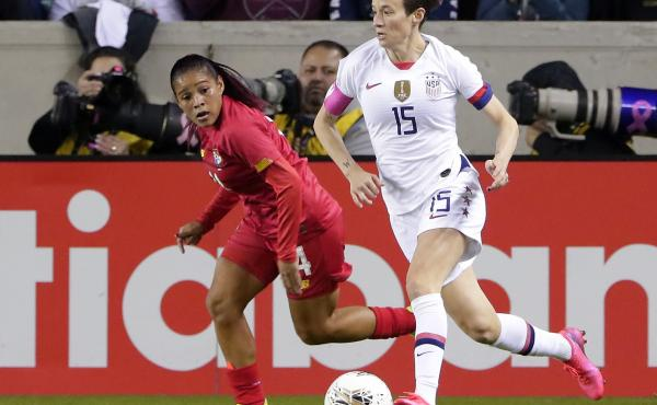 The U.S. Women's National Soccer Team could qualify for the 2020 Olympics with a win over Mexico on Friday. U.S. forward Megan Rapinoe (right) moves against Panama's Maryorie Perez during a CONCACAF match last month in Houston.