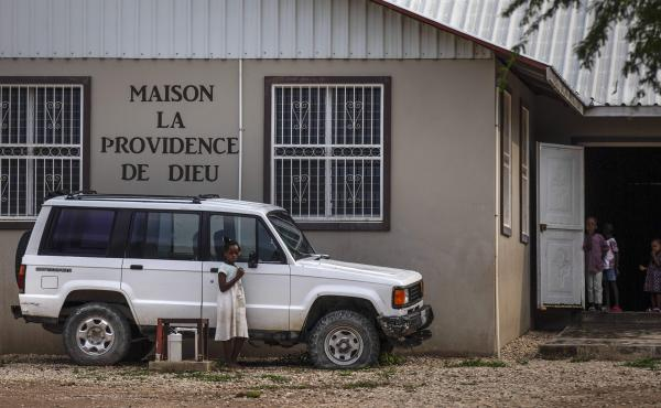 Children stand in the courtyard of the Maison La Providence de Dieu orphanage it Ganthier, Croix-des-Bouquets, Haiti, Sunday, Oct. 17, 2021, where a gang abducted 17 missionaries from a U.S.-based organization. The 400 Mawozo gang, notorious for brazen ki