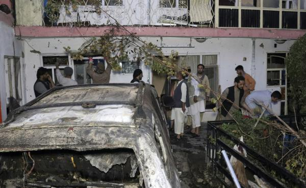 Afghans inspect damage of the Ahmadi family house after a U.S. drone strike in Kabul, Afghanistan, on Aug. 29. The strike, which the Pentagon originally deemed a success in striking an ISIS-K target, killed 10 civilians, none of whom were associated with