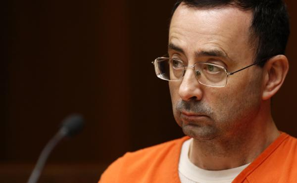Former Michigan State University and USA Gymnastics doctor Larry Nassar is seen in court on June 23 in Mason, Mich., as he stood trial on multiple counts of first-degree criminal sexual conduct. Nassar has pleaded guilty and faces decades in prison.