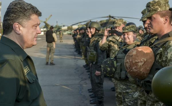 Ukraine's President Petro Poroshenko, left, meets with government troops in the embattled town of Mariupol the country's restive Donetsk Region.
