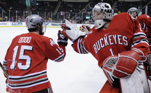 Logan Davis #1 congratulates Ohio State Buckeyes teammate Nick Oddo #15 for scoring a goal on March 22, 2014.