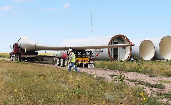 Rob Van Vleet secures a wind turbine blade on to an oversize truck at the Kimball Wind Farm in southwest Nebraska.