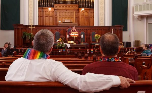 Daron Smith, left, and his husband, Chris Finley, right, worship at a Sunday morning service at Lafayette Park United Methodist Church in St. Louis, Mo. Smith, a lifelong United Methodist, said he feels hopeful ahead of a vote on LGBTQ ordination and same