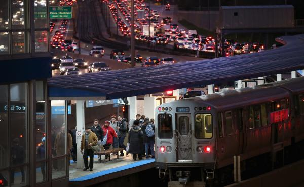 In Chicago, the Kennedy Expressway is clogged with cars as rush-hour commuters and Thanksgiving holiday travelers mix on Wednesday — one of the busiest travel days of the year.