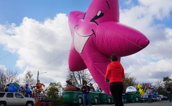 Volunteers learn how to handle balloons for the upcoming Thanksgiving Day parade in Detroit.