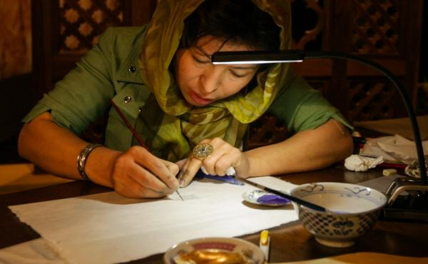 Afghan artist Sughra Hussainy, makes her own watercolors and pens to create intricate miniature paintings and calligraphy.