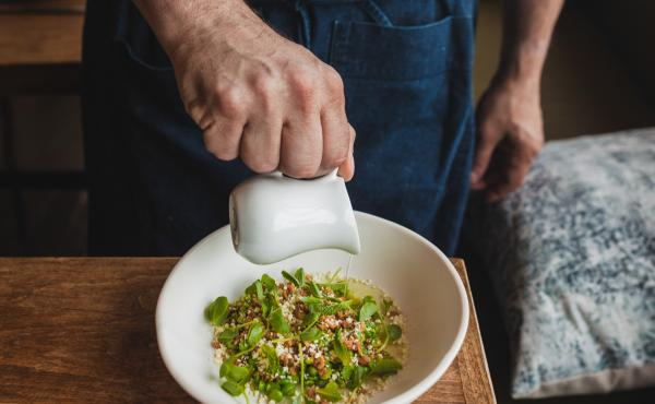 """Chef Jeremy Fox's inventive dish: double-chucked spring peas sprinkled with white chocolate and roasted macadamia nuts. It's served with a bit of pea broth poured on the side, """"to retain the crunch."""" Each pea is shucked, blanched and squeezed to get the h"""