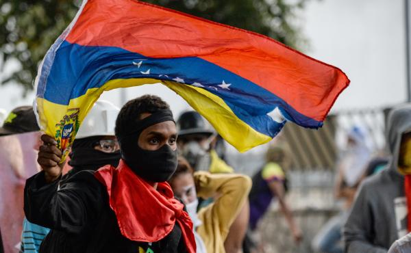 An anti-Maduro demonstrator waves the Venezuelan flag at a protest in the capital, Caracas, on Wednesday. The government banned such demonstrations nationwide for the next five days, as the country approaches a Sunday vote on delegates for Maduro's consti