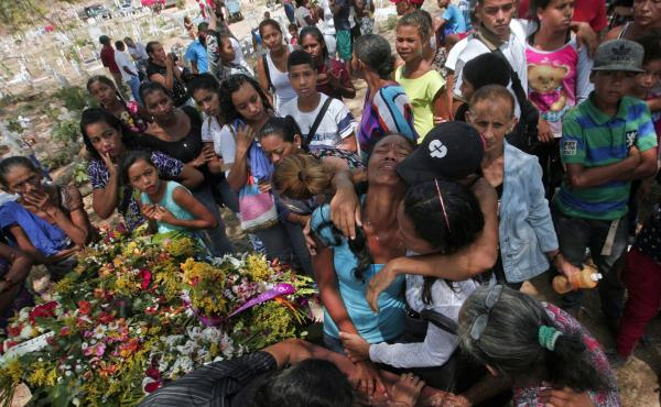 Relatives grieve during the funeral of some of the victims of the prison fire, in Valencia, northern Carabobo state, Venezuela, last week.
