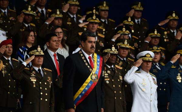According to The New York Times, Trump administration officials met with coup plotters who wanted to oust Venezuelan President Nicolas Maduro (center), shown here at a ceremony last month.
