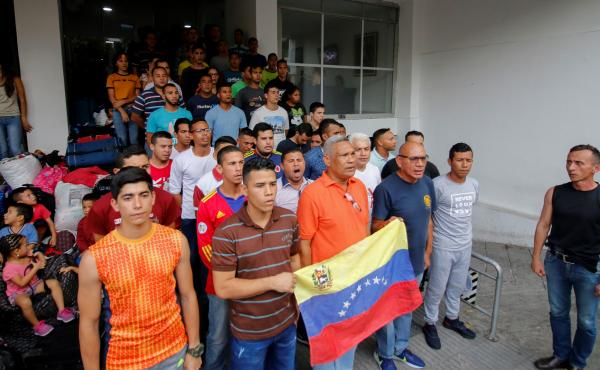 Venezuelan soldiers and policemen who deserted to Colombia protest after being evicted from the hotel where they were staying in Cúcuta in May. More than 1,400 members of Venezuelan security forces fled the country in February and March.