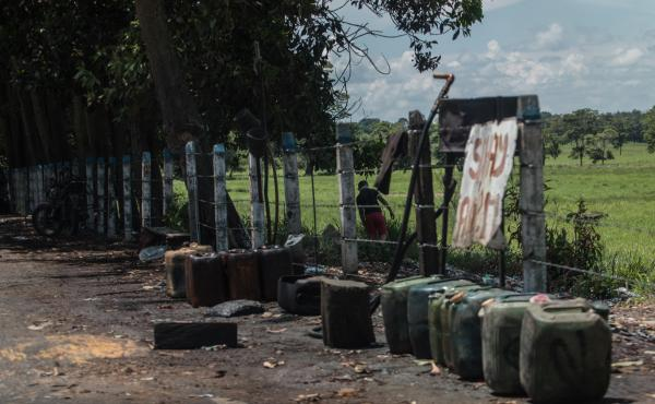 Contraband fuel sits on the side of a road in Puerto Santander, Colombia, on May 31, 2019. The Venezuelan government's lack of cash to import gasoline combined with U.S. sanctions targeting the oil sector have led to chronic fuel shortages in Venezuela. T