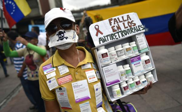 HIV-positive patients and their families protest hospitals' lack of medicines and supplies in Caracas, Venezuela, in April 2018. Some patients are fleeing to neighboring countries like Peru in search of lifesaving anti-retroviral drugs.