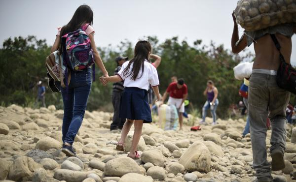 Venezuelan Leidy Navarro (left) walks with her daughter Valentina Caceres back to their home in Ureña, Venezuela, after picking her up at school in Cúcuta, Colombia, in March.