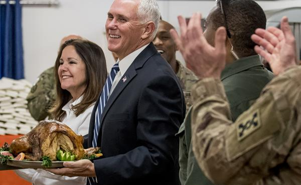 Vice President Mike Pence and his wife Karen Pence arrive with turkey to serve to U.S. troops at Al Asad Air Base, Iraq, Saturday, Nov. 23, 2019.